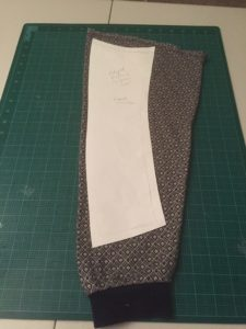 Side panel placement on sleeve fabric