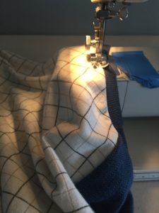 Top stitching the neck band