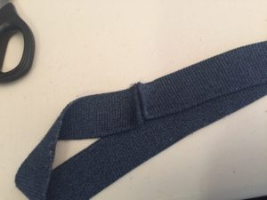 Neck band ends sewn together